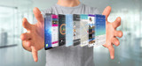 Businessman holding 3d rendering app template on a smartphone - 208473278