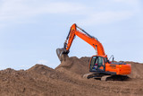 Earthworks Construction Operating Excavator Machine moving sand closeup photo. - 208474679