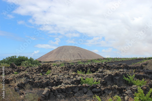 volcano at Lanzarote with blue sky and clouds