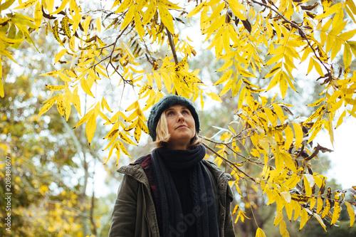 girl under autumn tree