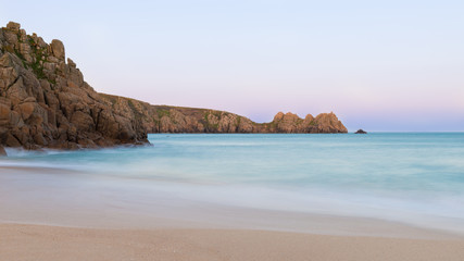 Stunning sunset landscape image of Porthcurno beach on South Cornwall coast in England © veneratio