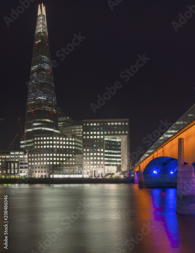 Fotobehang London Beautiful London City skyline landscape at night with glowing city lights and iconic landmark buldings and locations