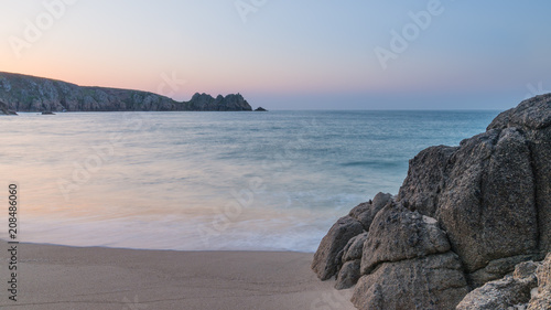 Aluminium Grijs Stunning vibrant sunrise landscape image of Porthcurno beach on South Cornwall coast in England