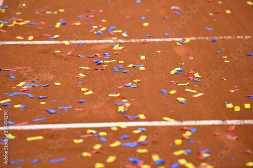 Fototapeta Confetti on a tennis clay court