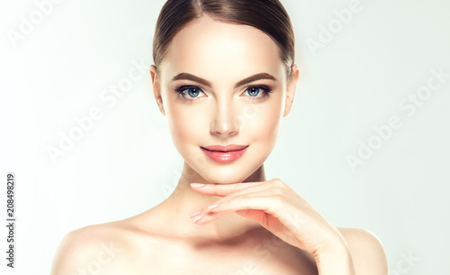 Aluminium Spa Beautiful Young Woman with Clean Fresh Skin look away .Girl beauty face care. Facial treatment . Cosmetology , beauty and spa .