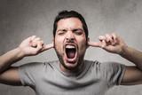 Man screaming loud - 208502607