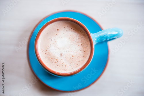 Fotobehang Chocolade Hot chocolate in blue cup