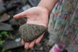 Closeup of a girl's hand holding a rock