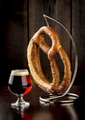 Fresh baked pretzel and frosty glass of beer