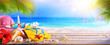 Leinwanddruck Bild - Vacation Concept - Beach Accessories On Table In Tropical Seascape