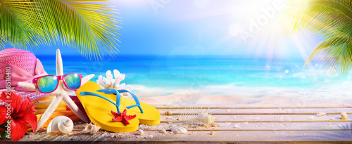 Leinwanddruck Bild Vacation Concept - Beach Accessories On Table In Tropical Seascape