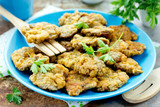 Crispy deep fried chicken livers coated with egg and bread crumbs - 208520022
