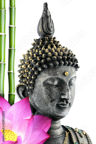 Fotobehang Boeddha Buddha face with lotus flower and bamboo stem