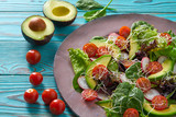 Avocado salad with sprouts tomatoes spinach - 208527423