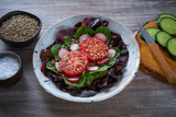Tomato salad with seeds radish spinach lettuce - 208527602