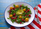 Avocado and berries salad with arugula and tomato - 208527607
