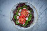 Tomato salad with seeds radish spinach lettuce - 208527642