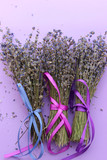Bundles of dried lavender bandaged with ribbon on purple background, top view - 208533877