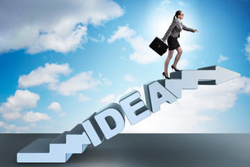 Concept of idea with businesswoman climbing steps stairs