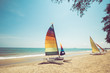 Colorful sailboat on tropical beach in summer. vintage coor effect.