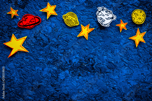 Space concept. Drawn stars, planets, asteroids on blue outer space background top view copy space - 208559805