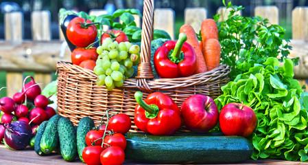 Variety of fresh organic vegetables in wicker basket