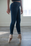 Young Woman in Ballet Shoes and Jeans Dancing in Studio - 208564026