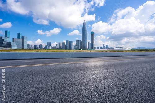 panoramic city skyline with empty asphalt road