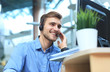 Leinwanddruck Bild - Smiling friendly handsome young male call centre operator.