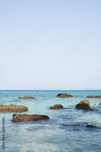 Fotobehang Thailand Stones in a blue sea. Island in Gulf of Thailand.