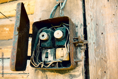 old electric power supply boxes  industrial background  overloaded  electrical circuit causing fuse to break