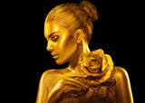 Golden skin woman with rose. Fashion art portrait. Model girl with holiday golden glamour shiny professional makeup. Gold jewellery, accessories - 208577269