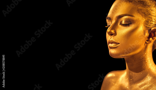 Leinwanddruck Bild Golden skin woman face. Fashion art portrait closeup. Model girl with holiday golden glamour shiny professional makeup. Gold jewelry, accessories