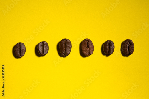 Fotobehang Koffiebonen coffee beans on color background with hard light pop art style