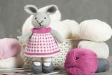 Handmade Knitted Rabbit Soft Toy. Yarn Balls. Knit Needles.