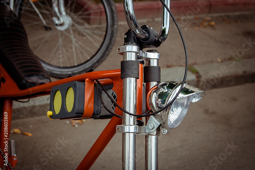 Fotobehang Fiets headlight and music concept with small loudspeaker on on the frame of the bike.