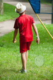 portrait of children with hat playing badminton in urban park back view - 208609407