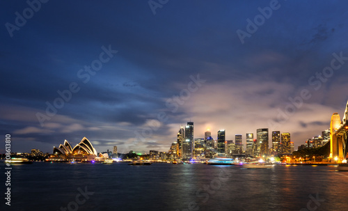 Fotobehang Sydney Panoramic image of Sydney, Australia with Harbour Bridge during twilight blue hour.