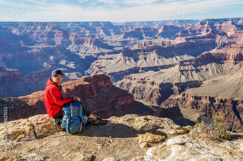 Fotobehang Arizona A hiker in the Grand Canyon National Park, South Rim, Arizona, USA