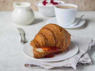 Tasty fresh croissant with jam. Breakfast.