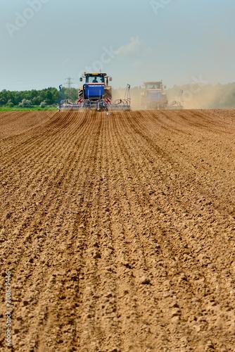 Foto Murales Two tractors drilling