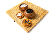 Go - The ancient Chinese strategy board game isolated on white