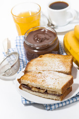 sweet sandwich with chocolate paste and banana for breakfast, vertical