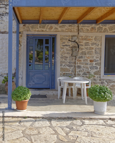 Greek island house entrance with blue door
