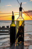 Olive Oil and Vinegar Bottle with Chili Pepper in the Holbox Island Sunset, Mexico - 208650220