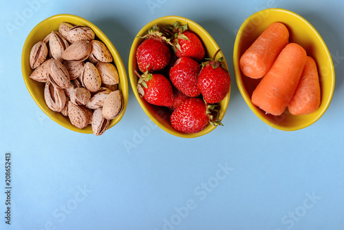 Foto Murales Ingredients for  healthy food on concrete grey background, top view