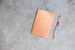 Glam rose gold glitter notepad with pen on grey