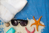 Sunglasses, towel and starfishes. Going to the beach, summer vacation concept - 208660630
