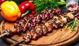 Chicken kebab on skewers with mushrooms and peppers and barbecue sauce on a black background. Food for a picnic. - 208662892