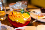 Fruit tea in glass pot - 208664644